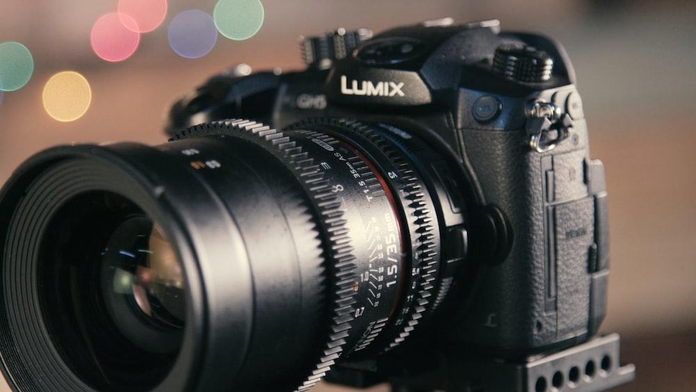 shallow focus photography of black Lumix DSLR camera