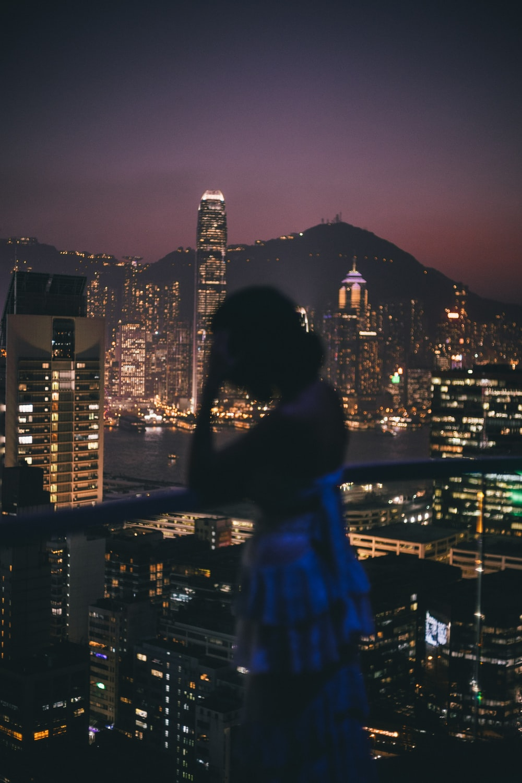 woman in backless top standing on veranda