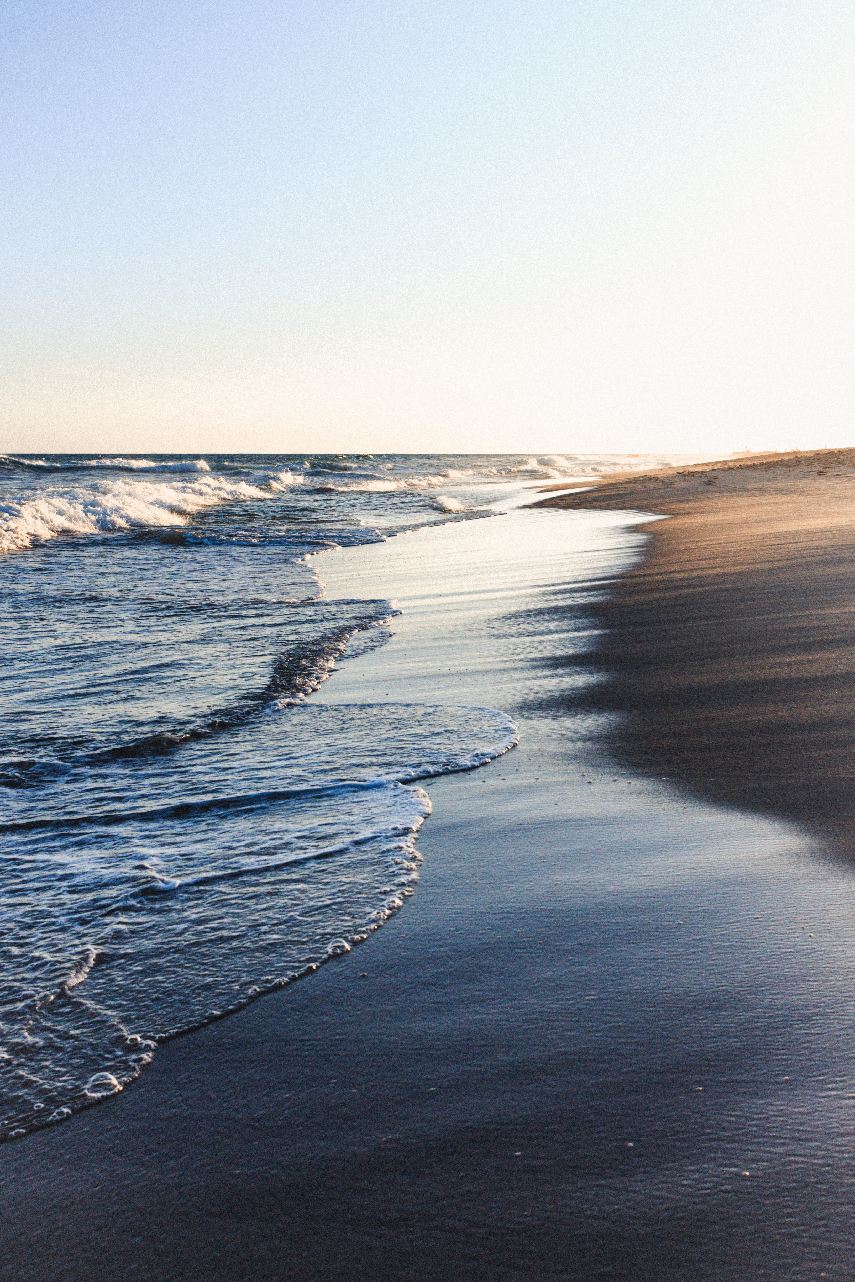 beach and sea waves during daytime