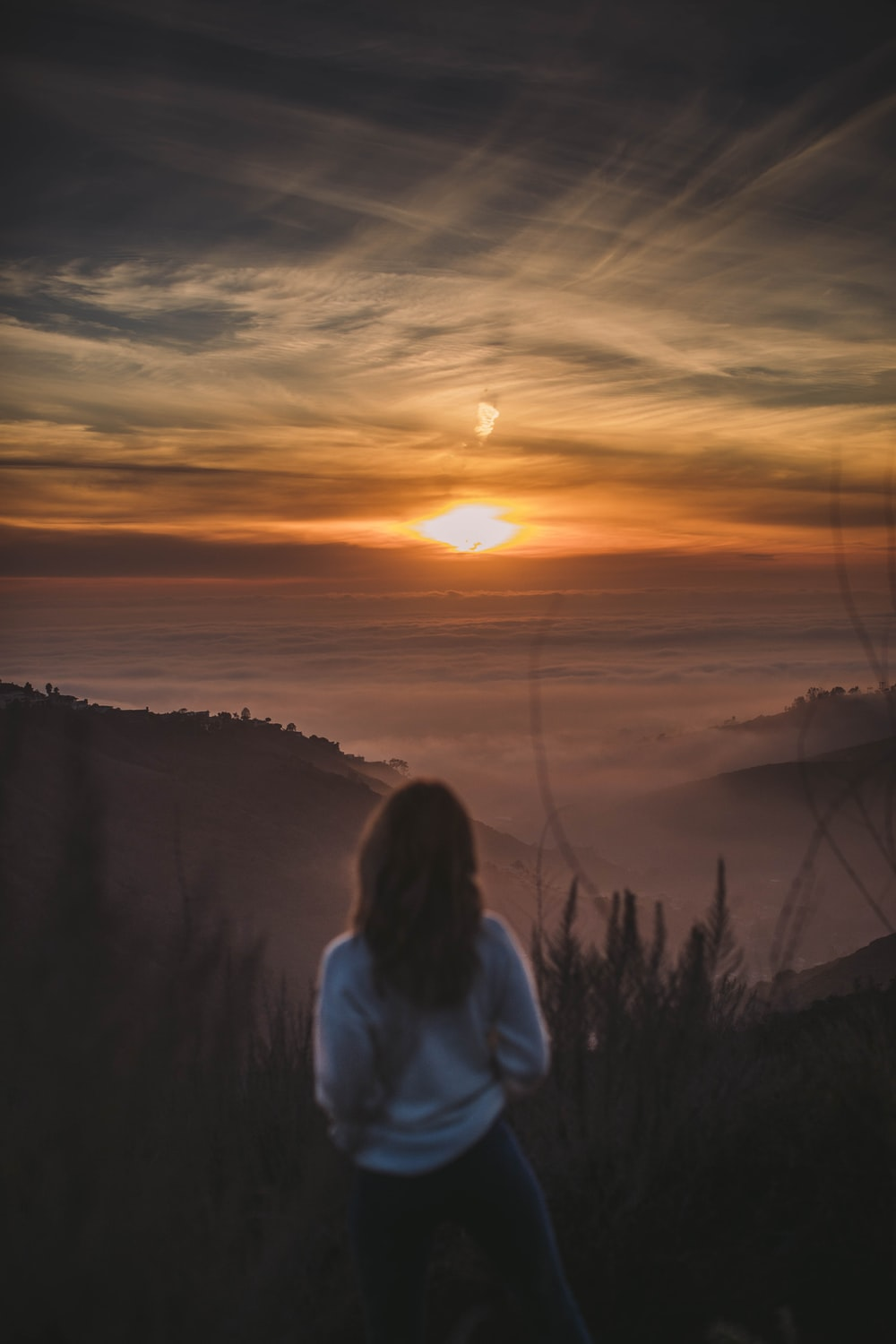 woman staring at the sunset