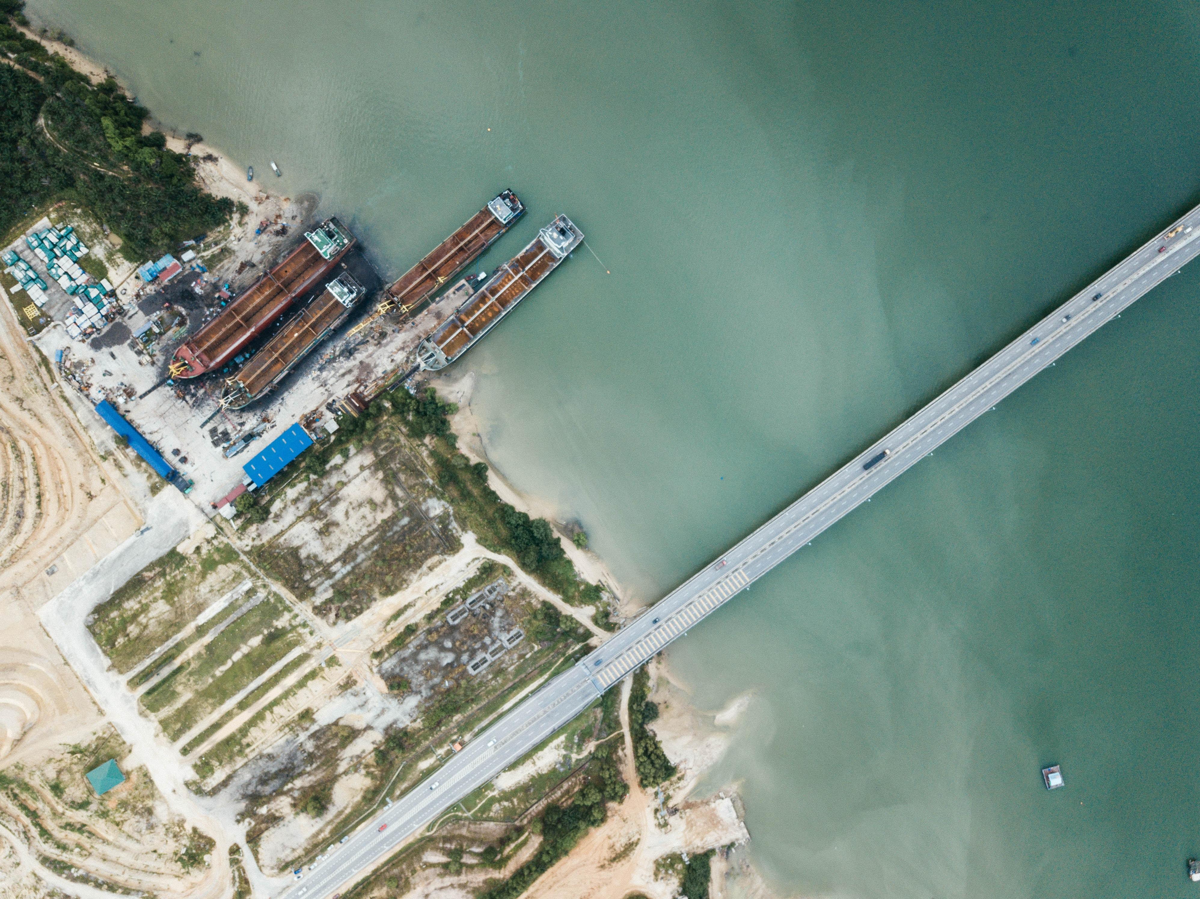 aerial photo of bridge and buildings