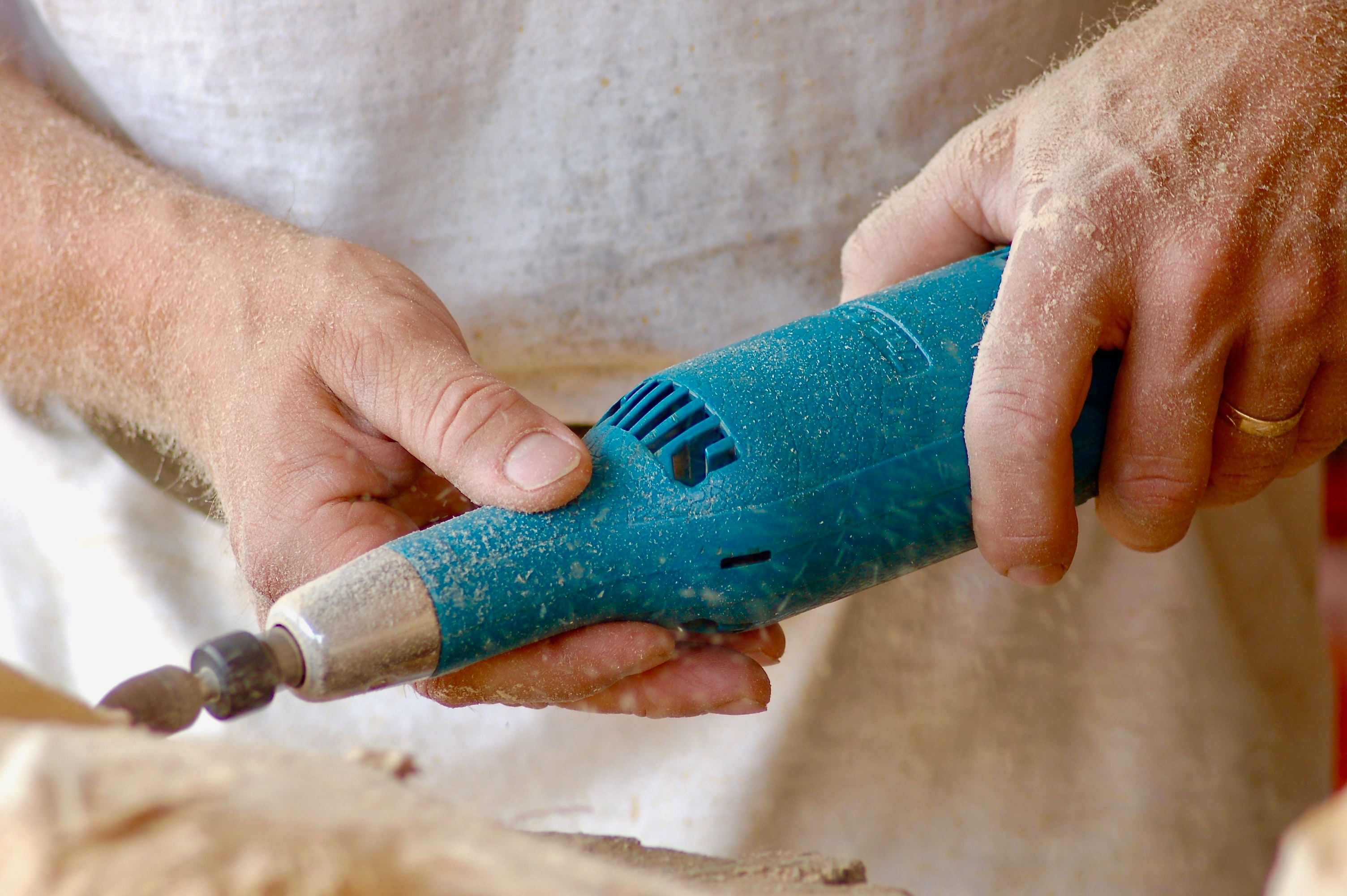 person holding blue power tool