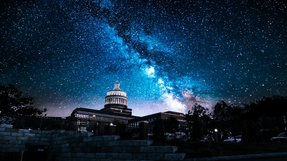 white and grey concrete building under starry night