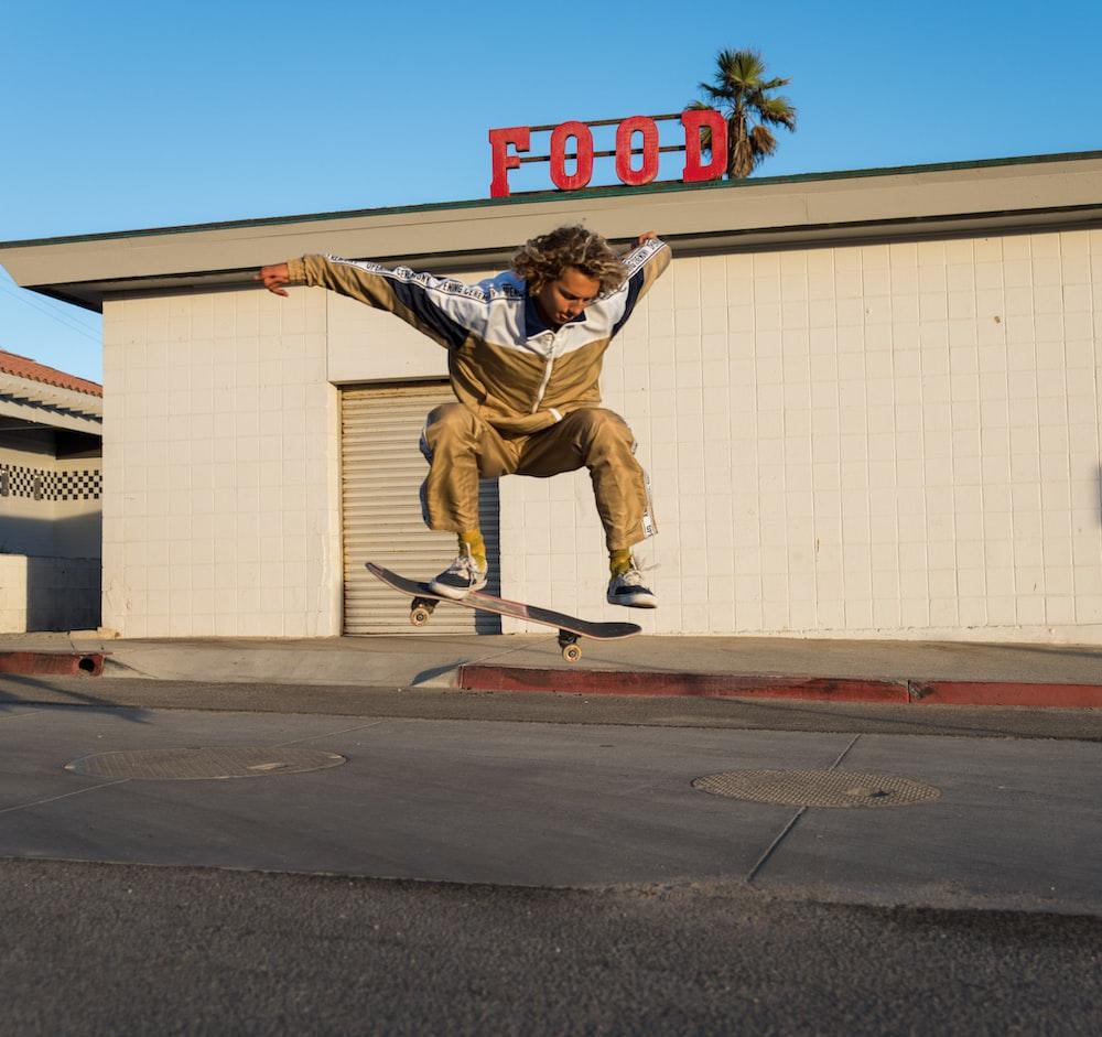 man making a jump skateboard trick