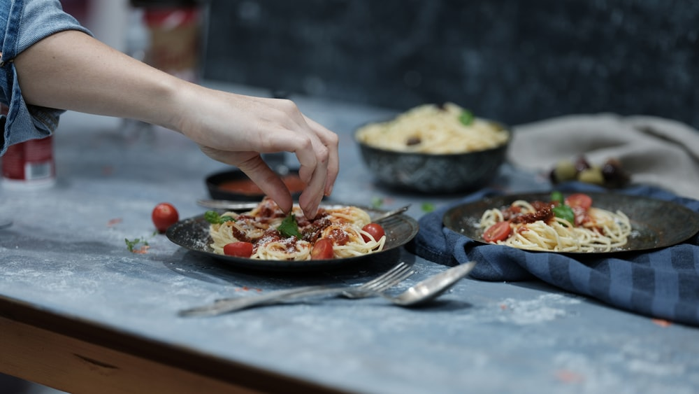 person holding spaghetti