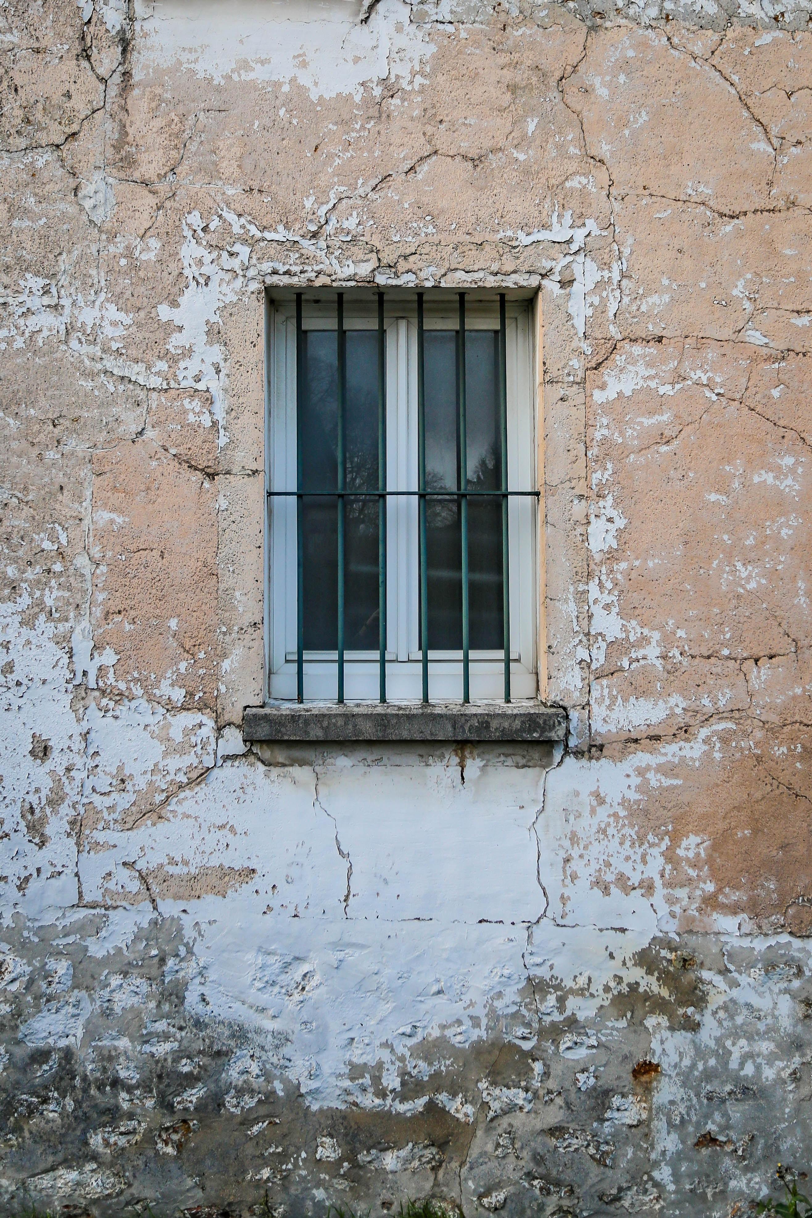 black metal window rail and white wooden framed glass window