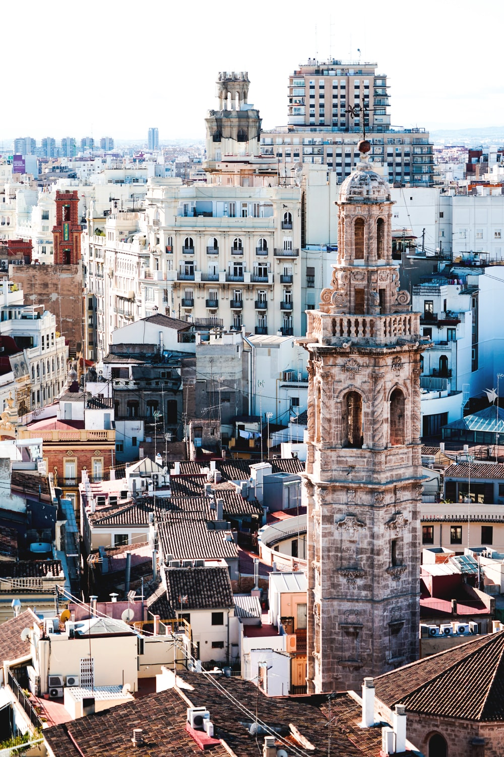 aerial photography of beige tower surrounded by houses during daytime