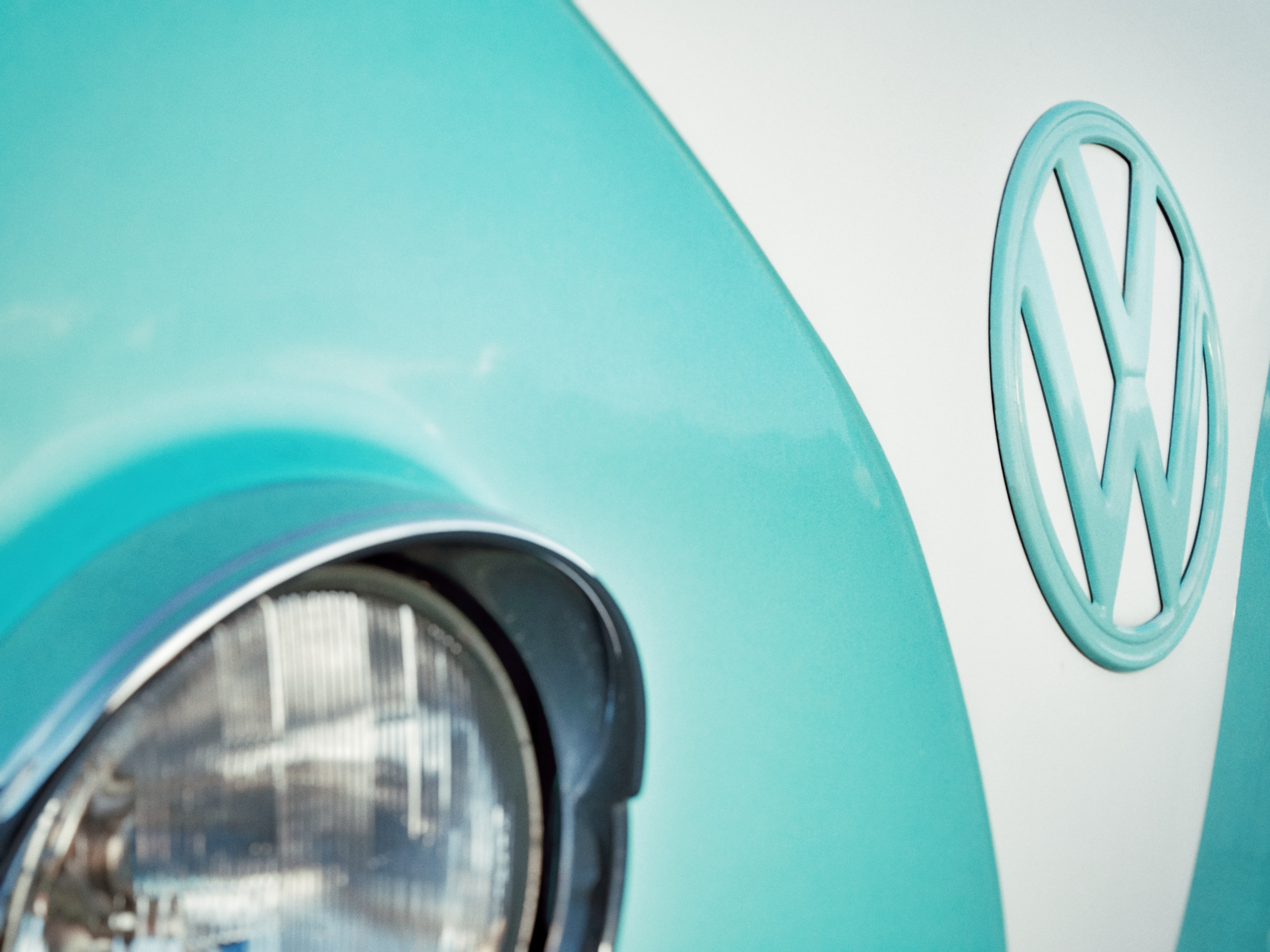 close-up photo of teal and white Volkswagen Type 1