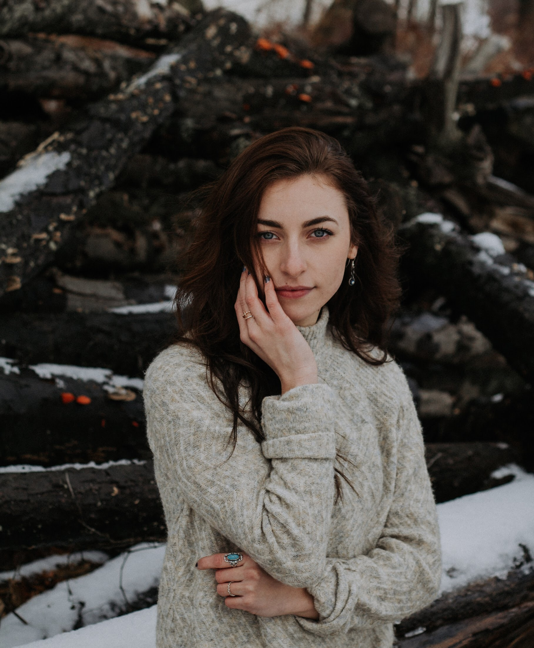 selective focus photography of woman in gray sweater
