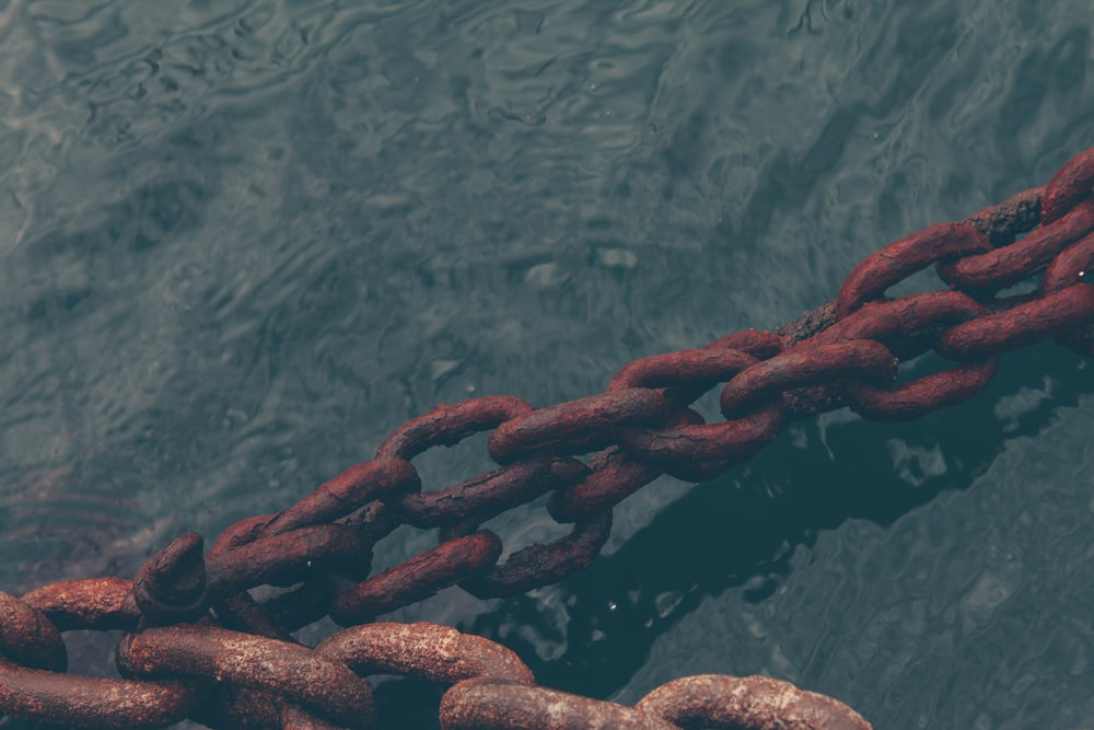 rusty chain on water