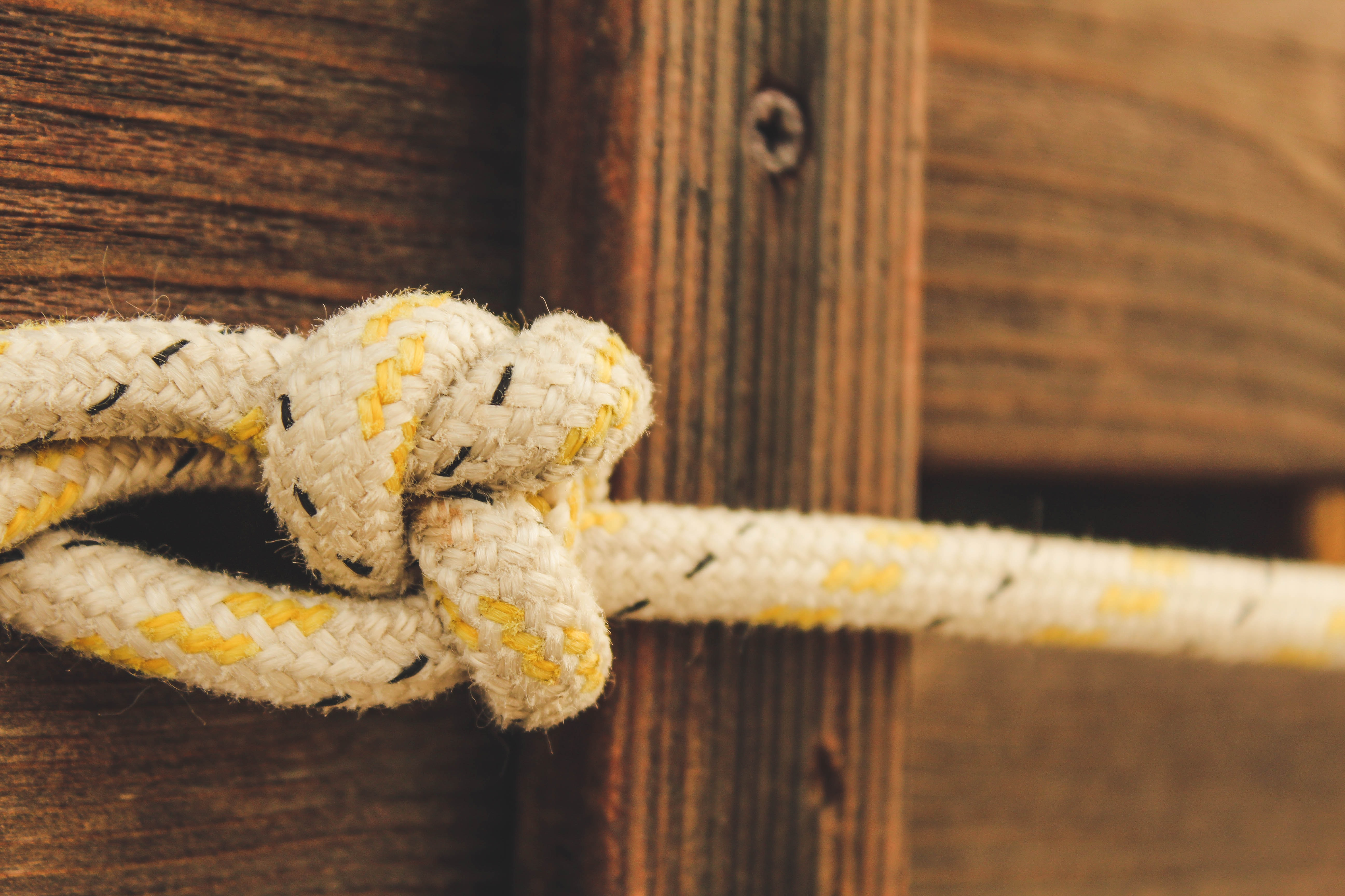 beige rope in bokeh photography