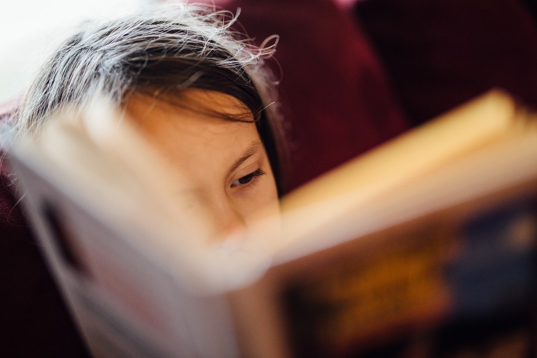 My daughter, reading a book.