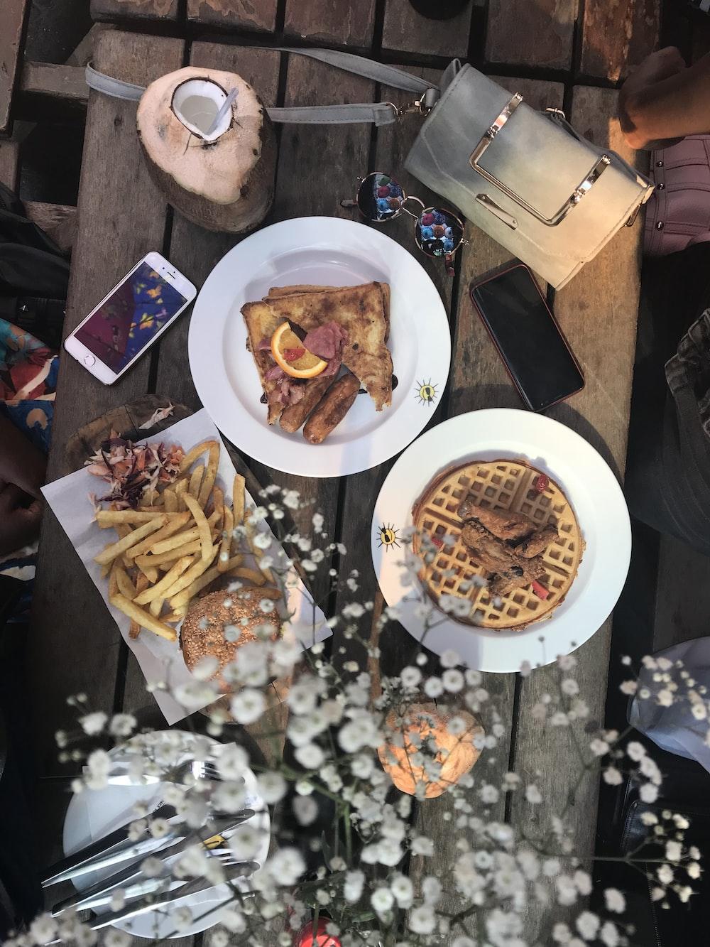 baked waffles on round white ceramic plates during daytime
