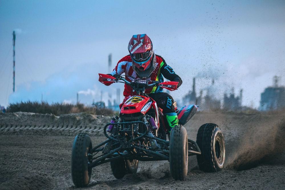 man riding all-terrain vehicle