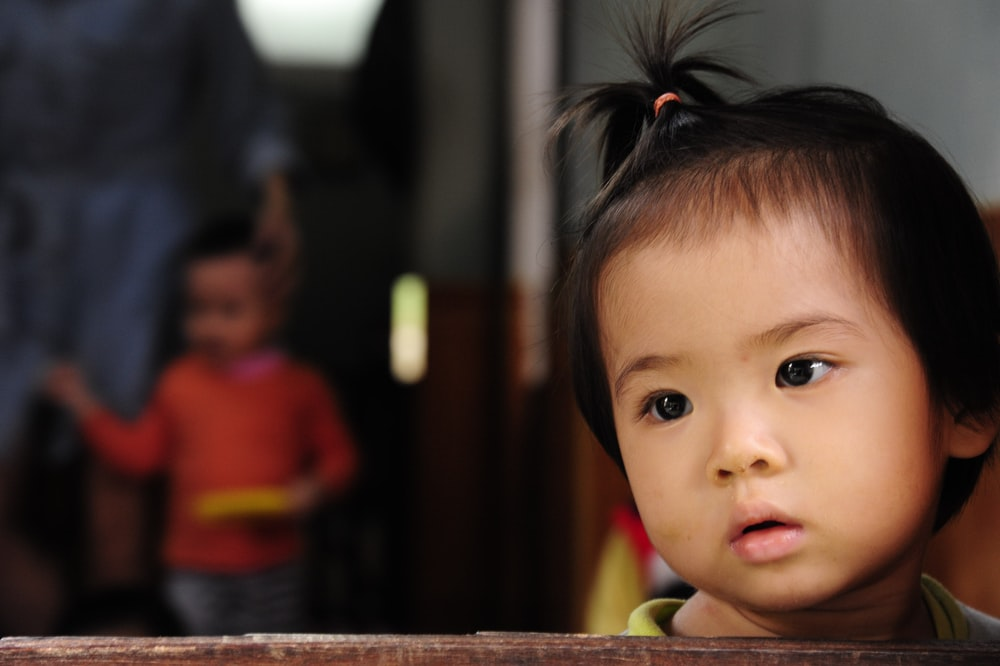child wearing pink scrunchies