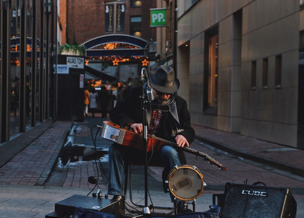 man performing as one-man band on street
