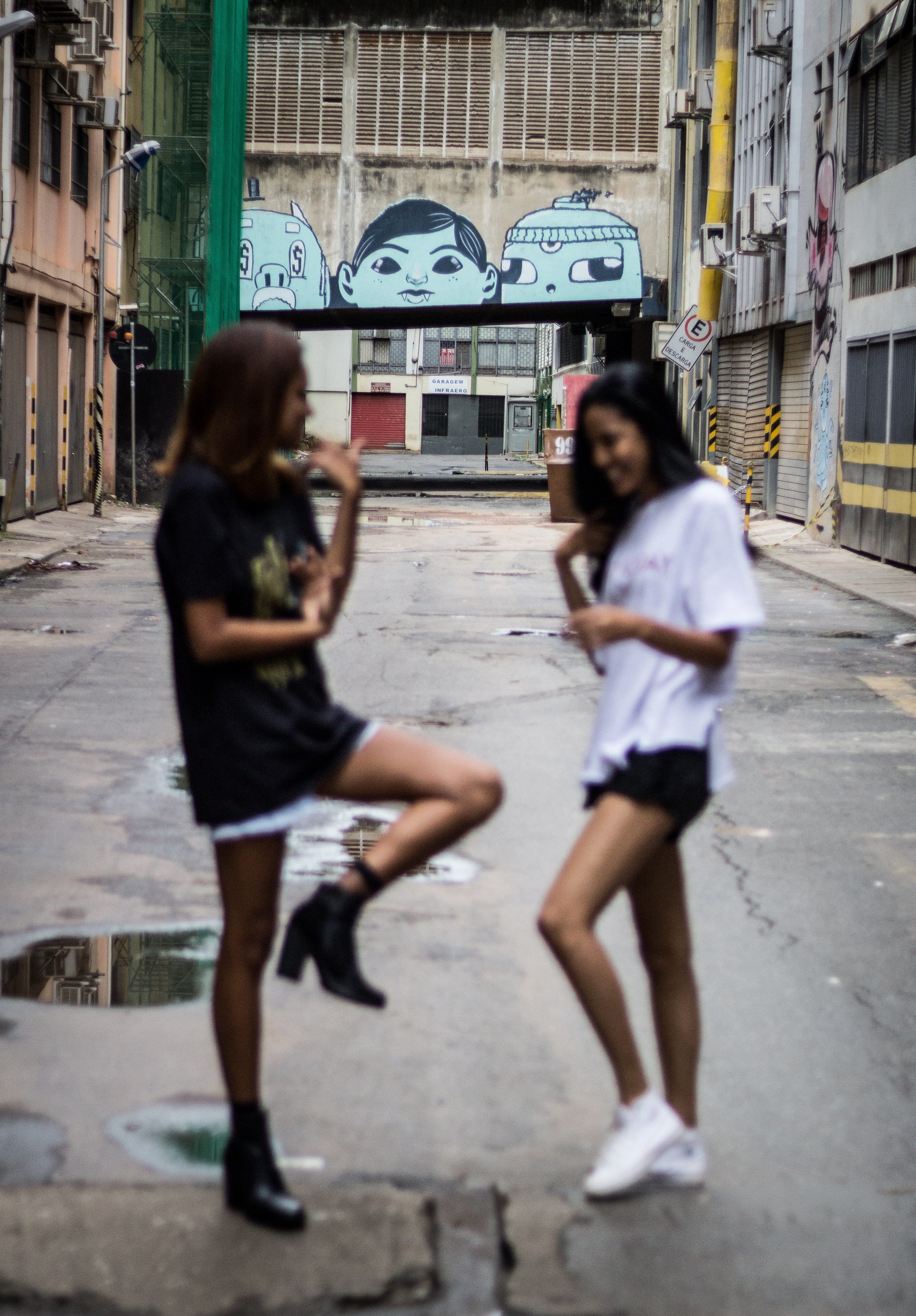 two women in the alley during daytime