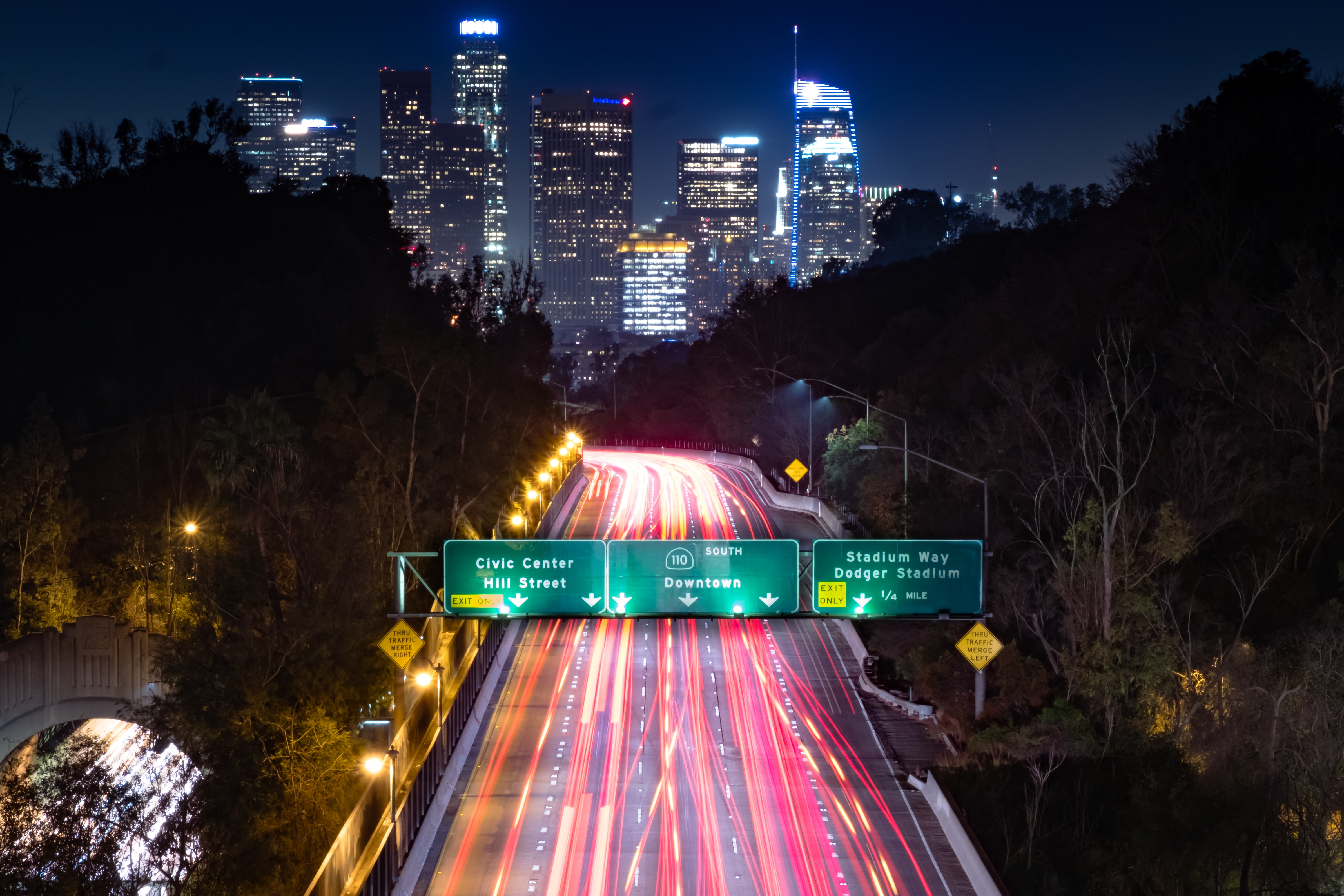 time lapse photography of highway leading to city