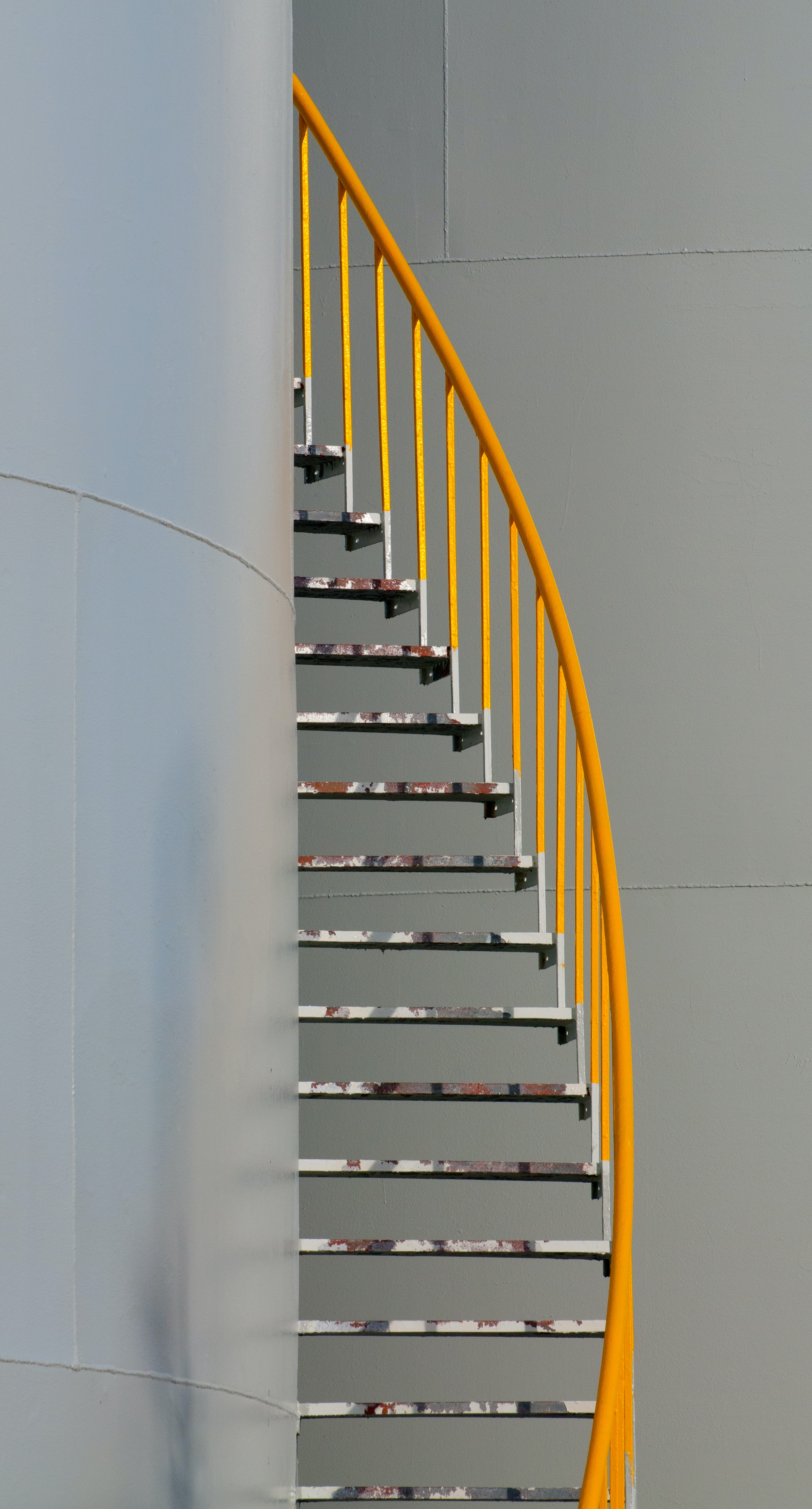 yellow and silver spiral staircase