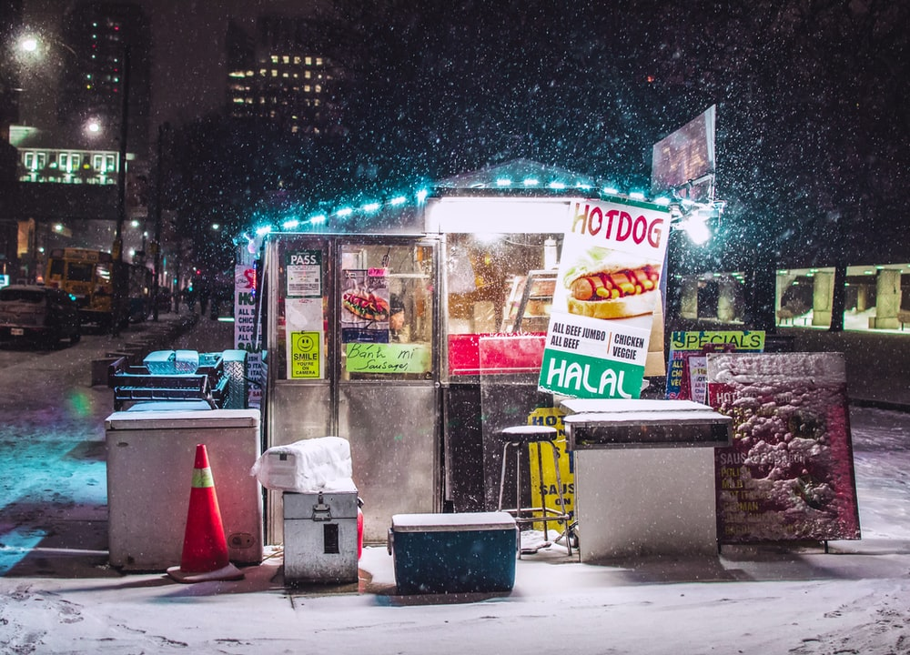 well-lighted food store during winter photo