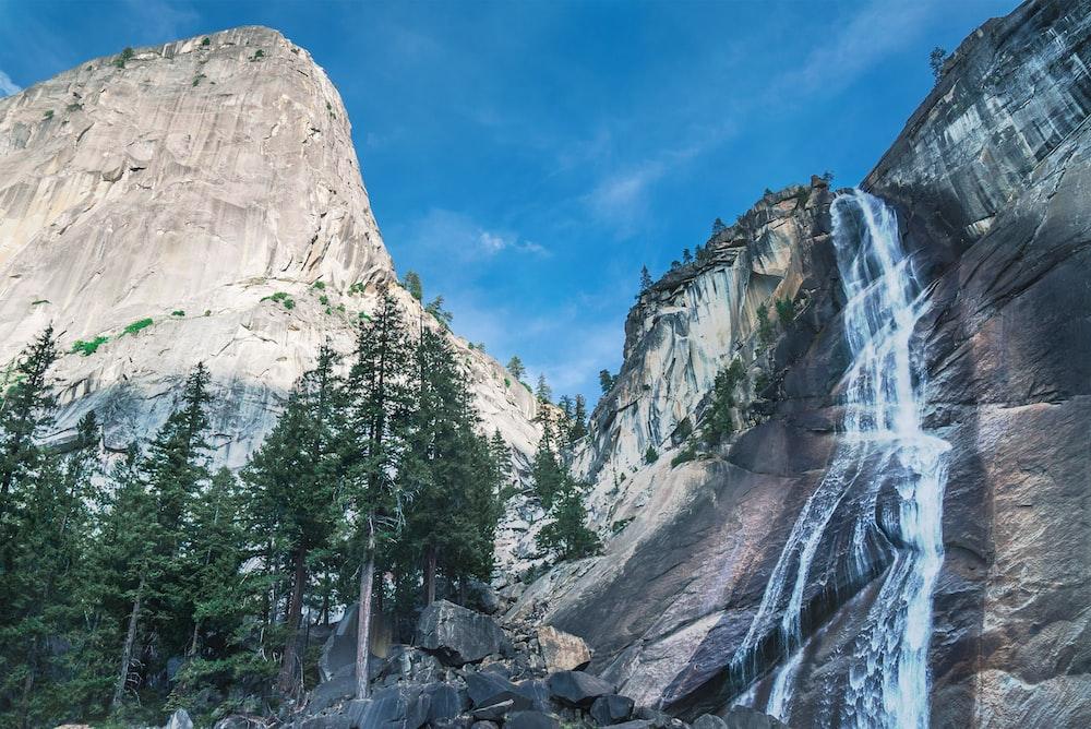 mountain with waterfalls during daytime