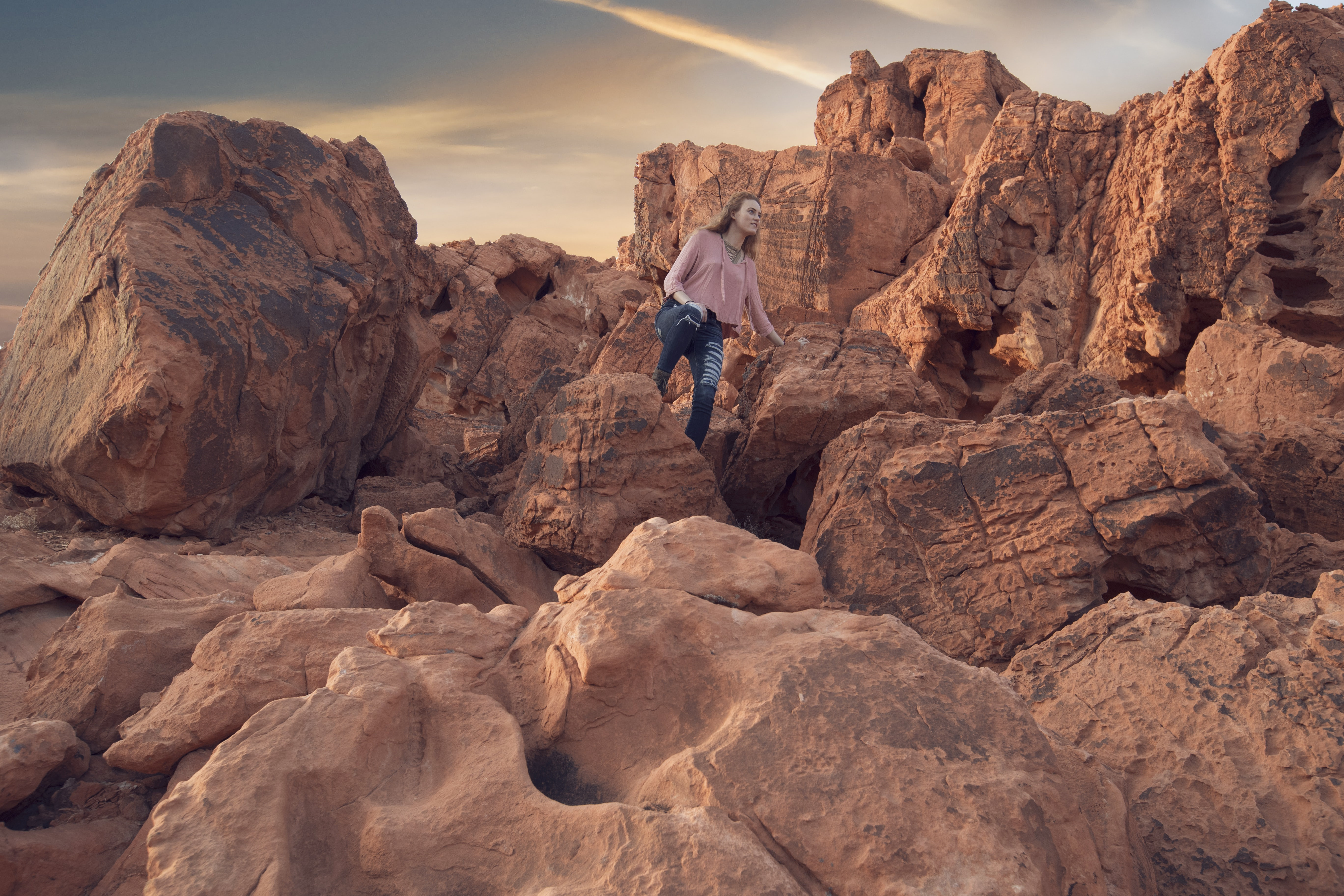woman standing on rock during daytime
