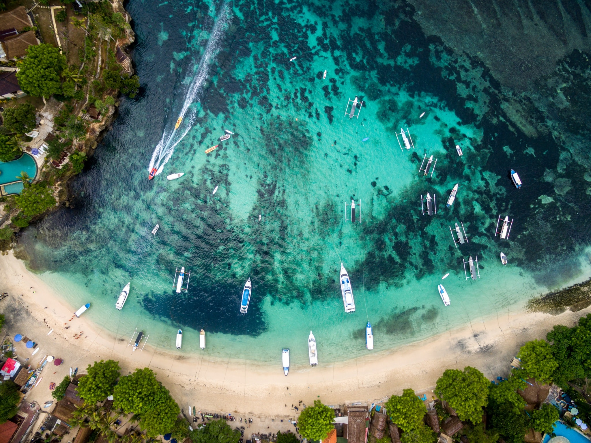 aerial photography of boats near shoreline at daytime