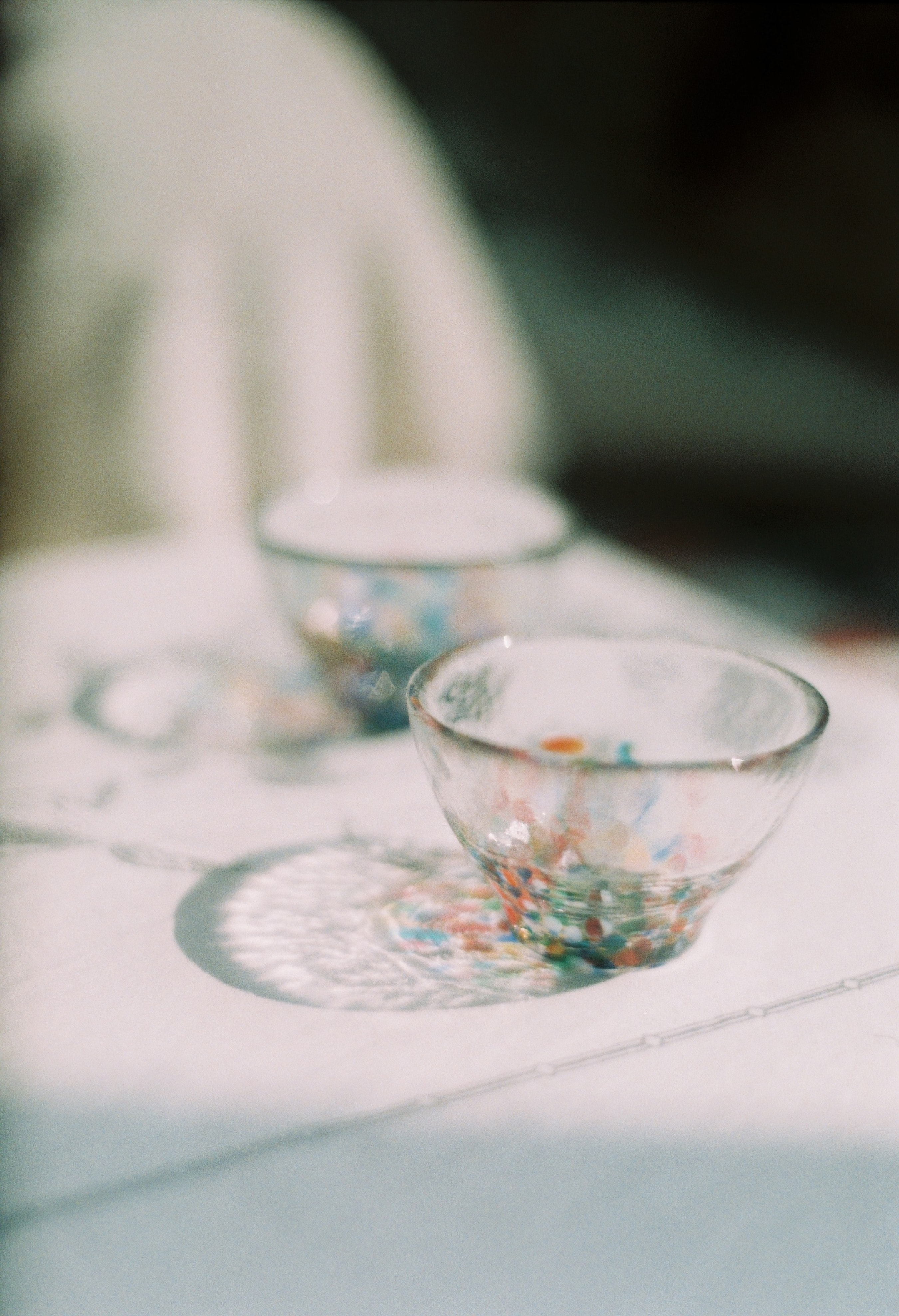 two empty glass bowls on white surfac e
