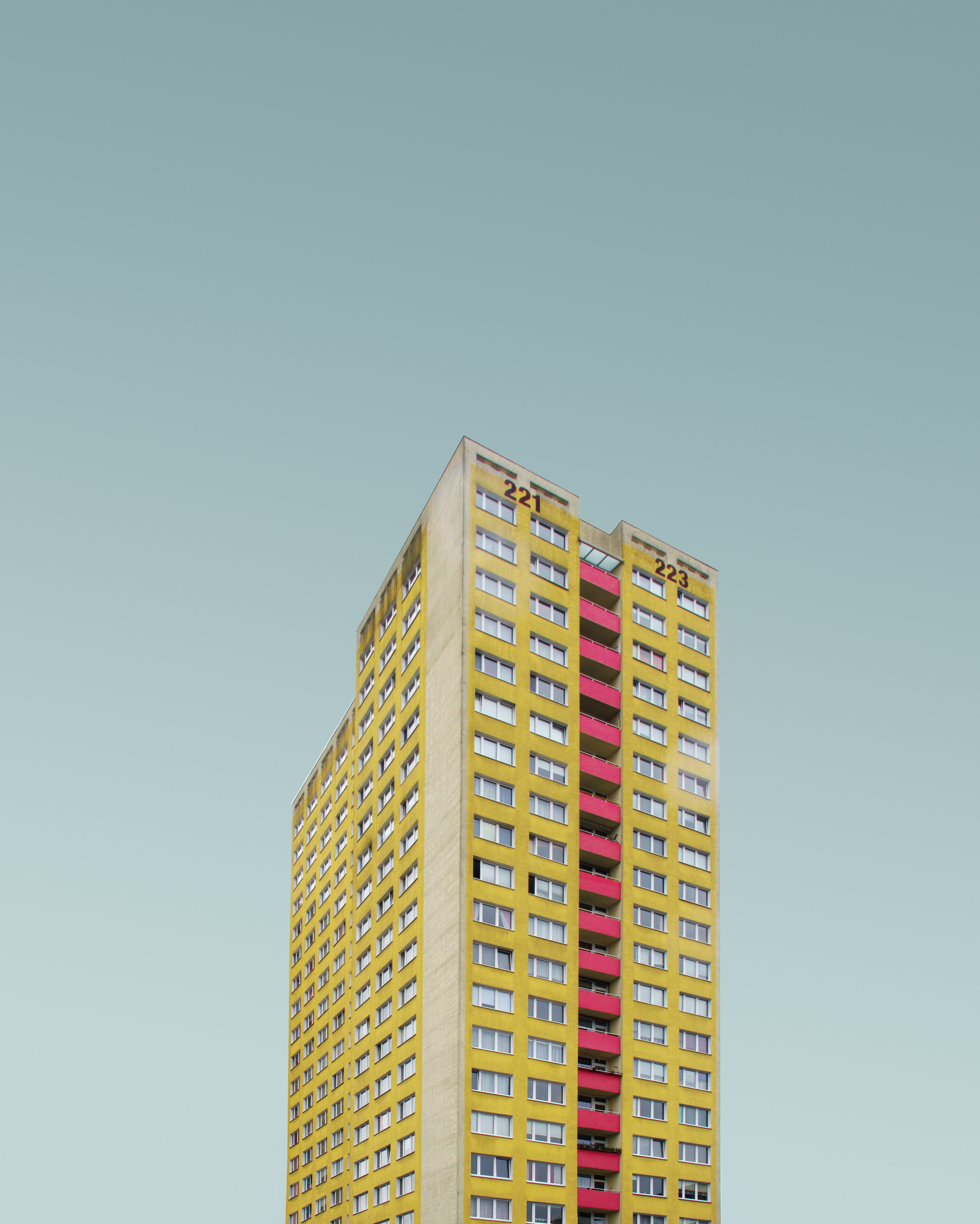 yellow and red high rise building