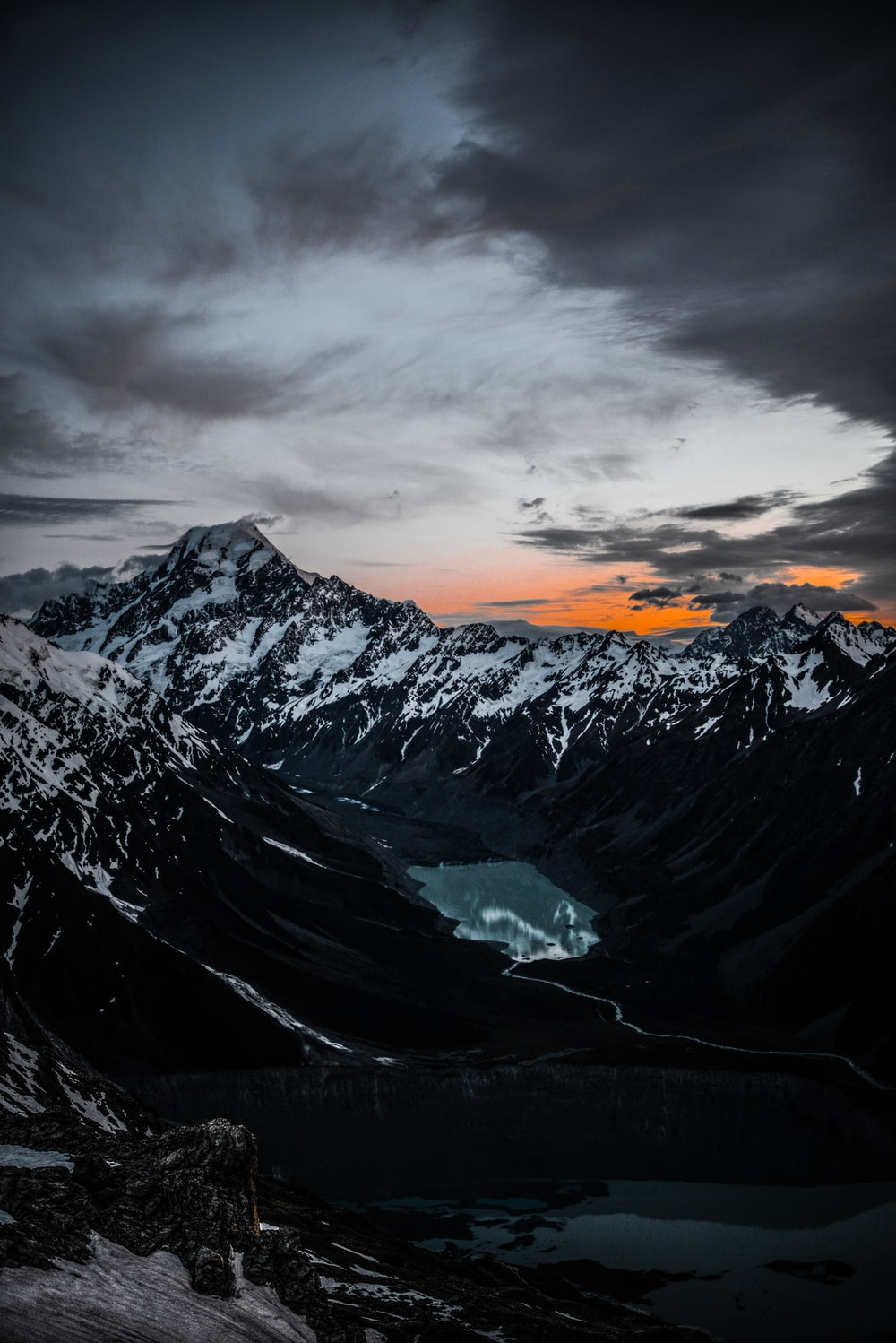 snow-covered mountain under sunset