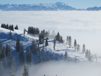 Amazing layers of clouds and mountains, with a cabin in the distance. #itsgreatoutthere