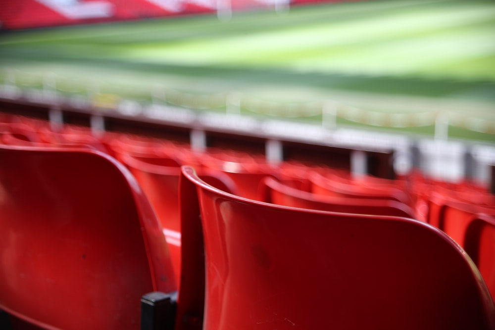 red plastic seats focus photography