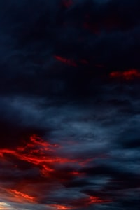 blue and red clouds painting