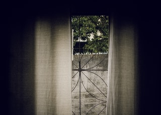 gray window curtain at daytime