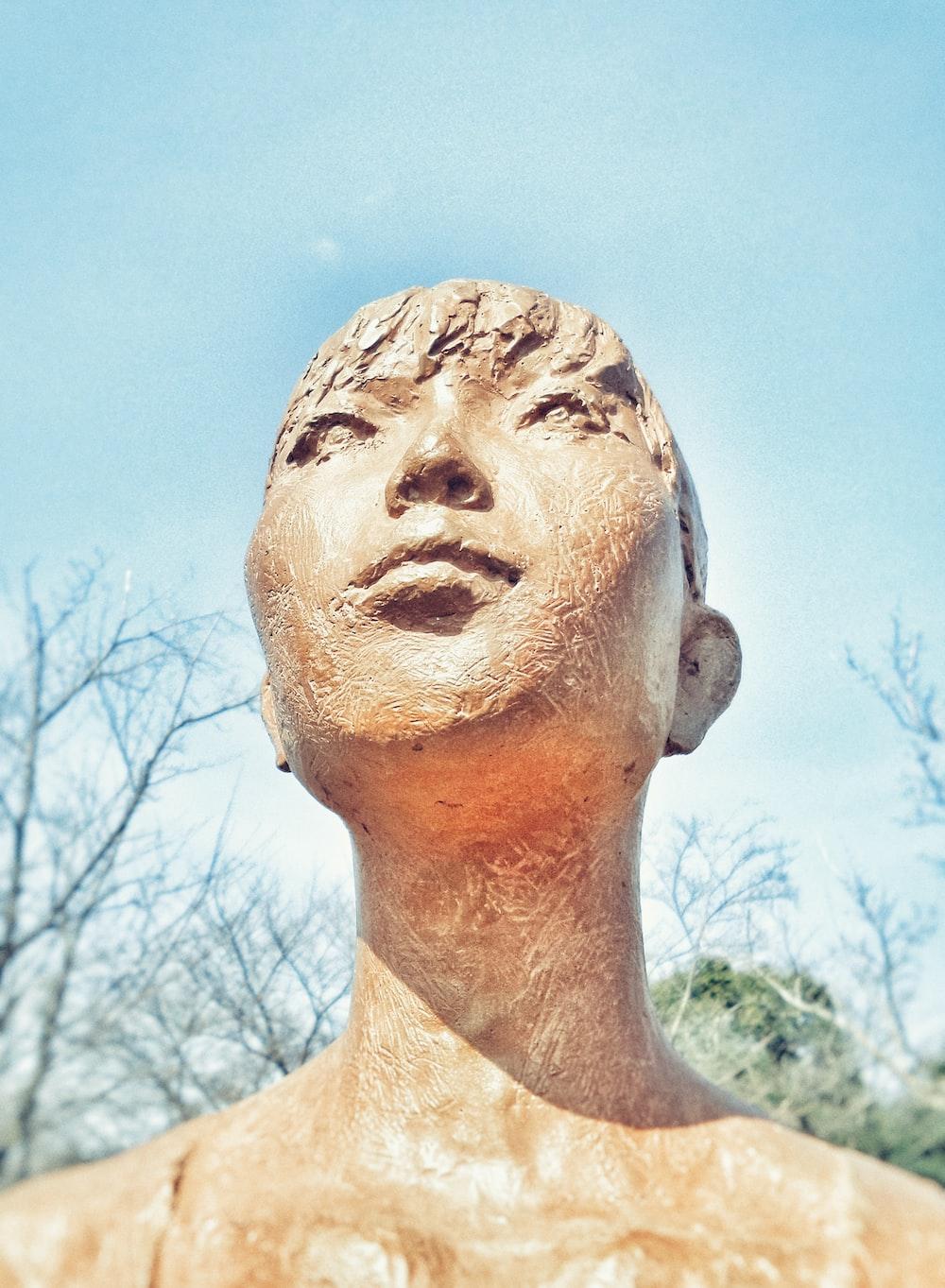 brown human statue