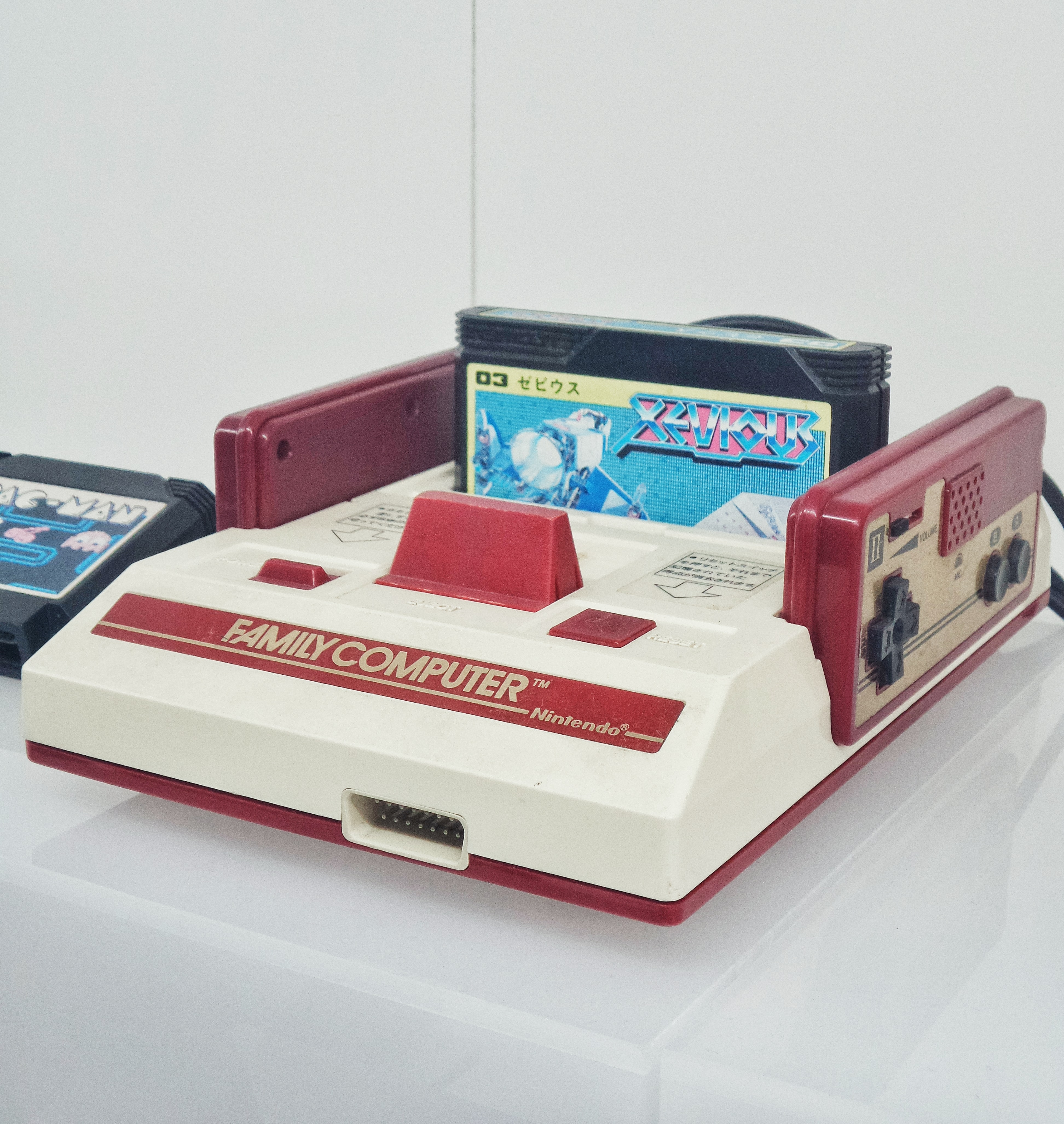 red and white Nintendo Family Computer console