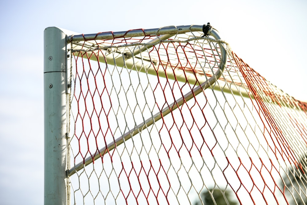 yellow and orange net with post