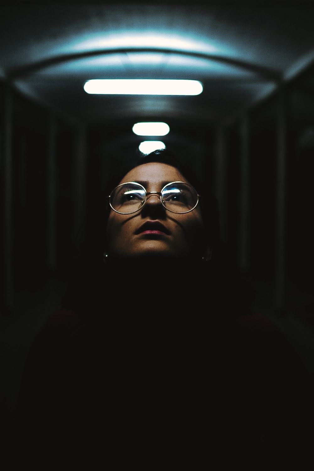 shallow focus photography of woman in clear eyeglases with silver frames