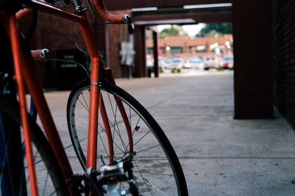red road bike on gray pavement flooring