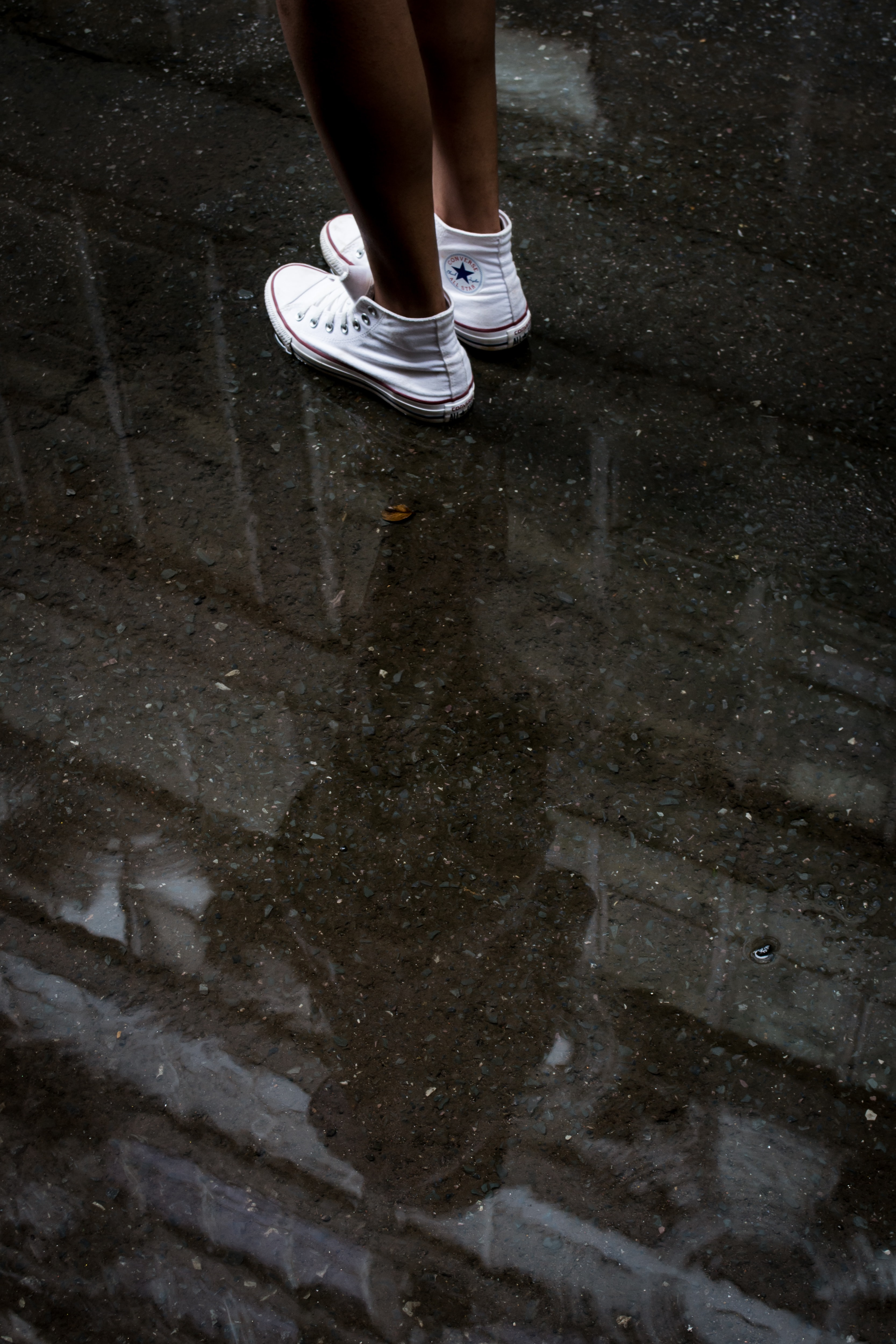 woman wearing pair of white Converse sneakers