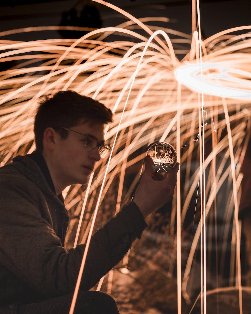 man holding crystal ball