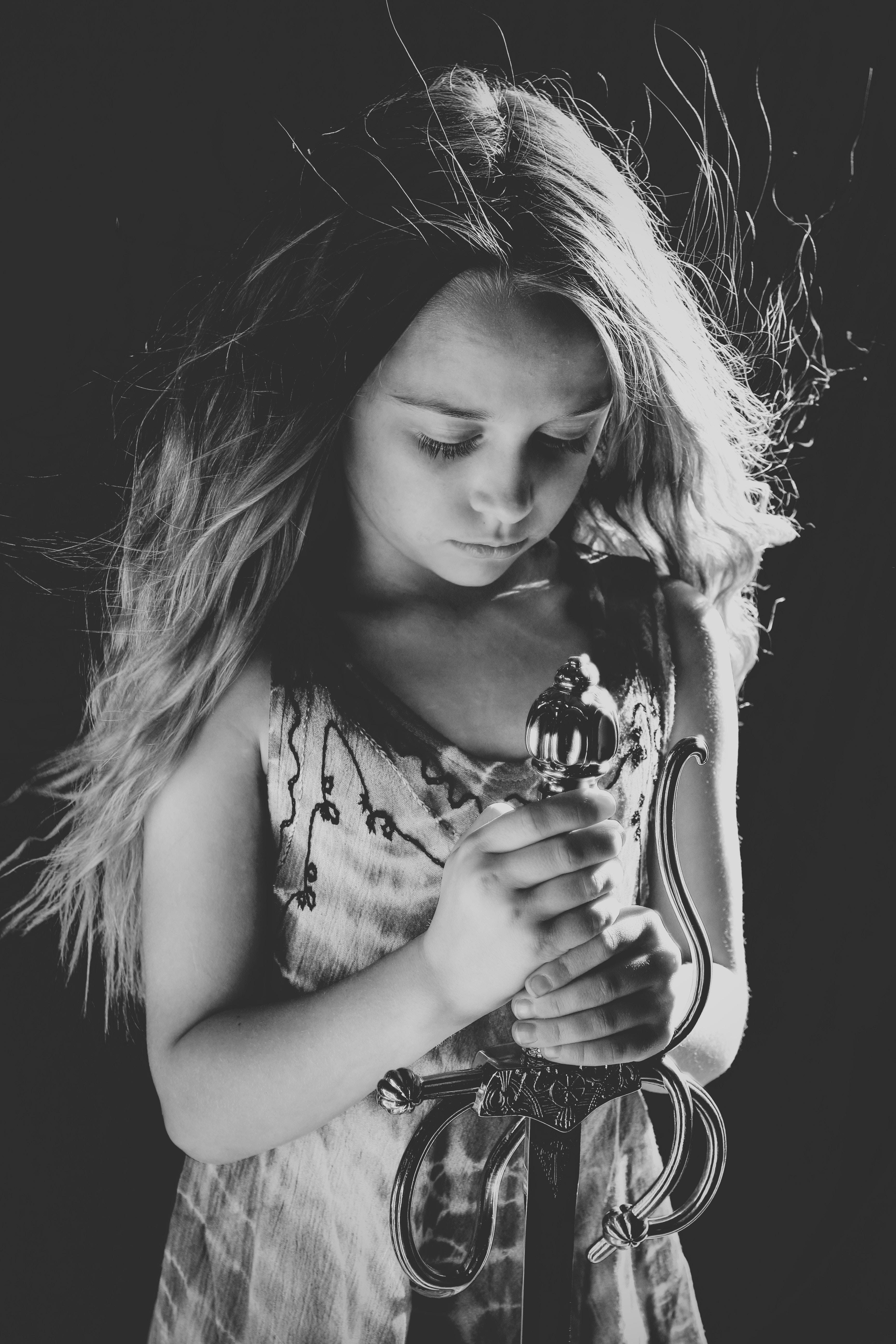 child holding sword