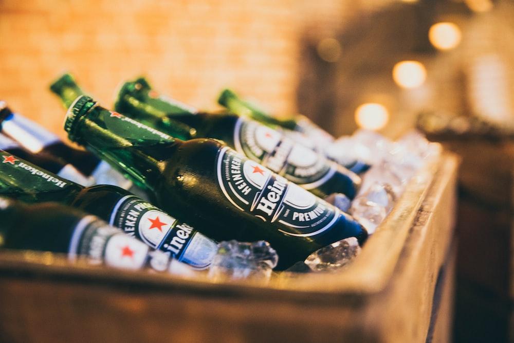 Heineken bottles placed on brown cooler box