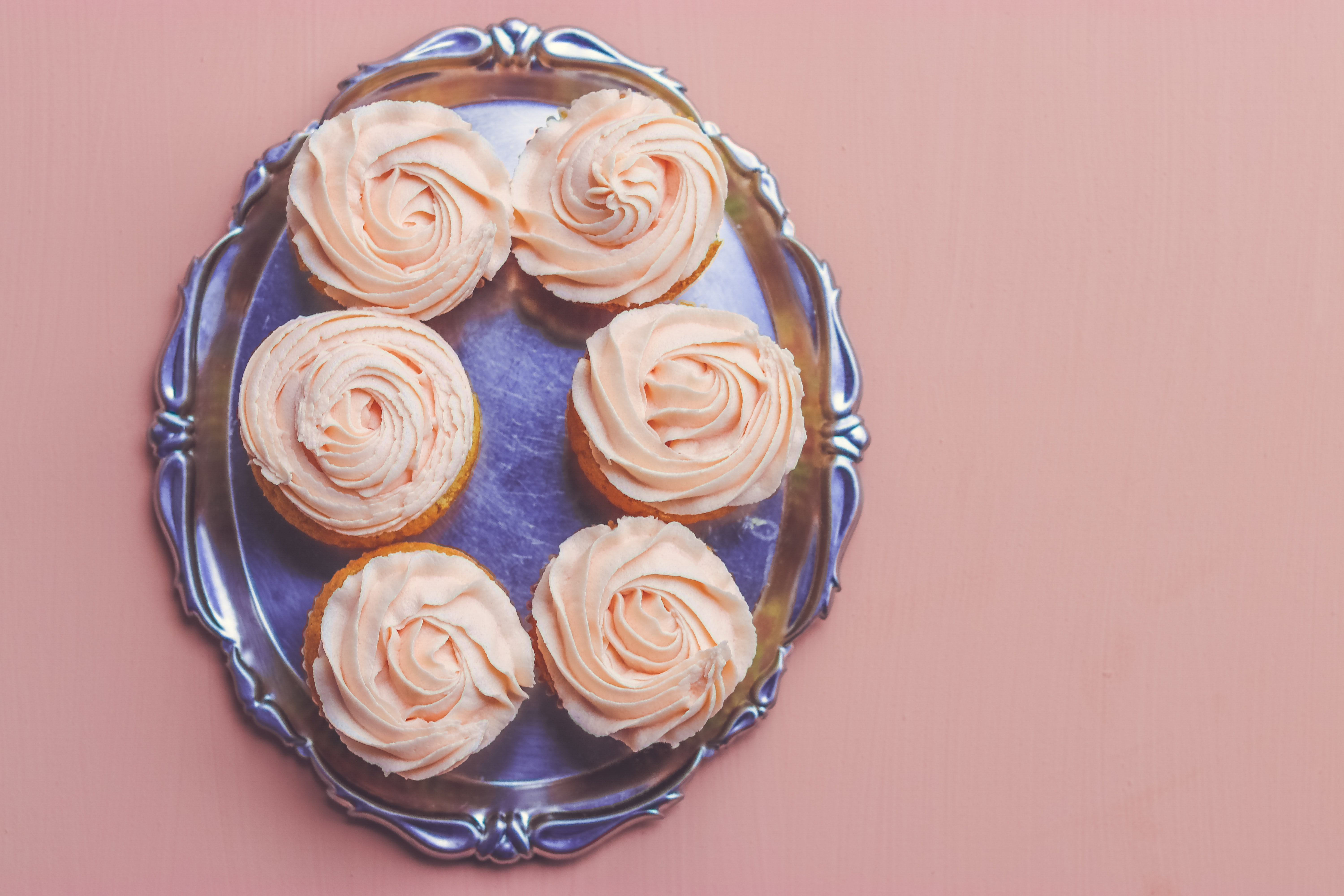 six cupcakes on stainless steel serving tray