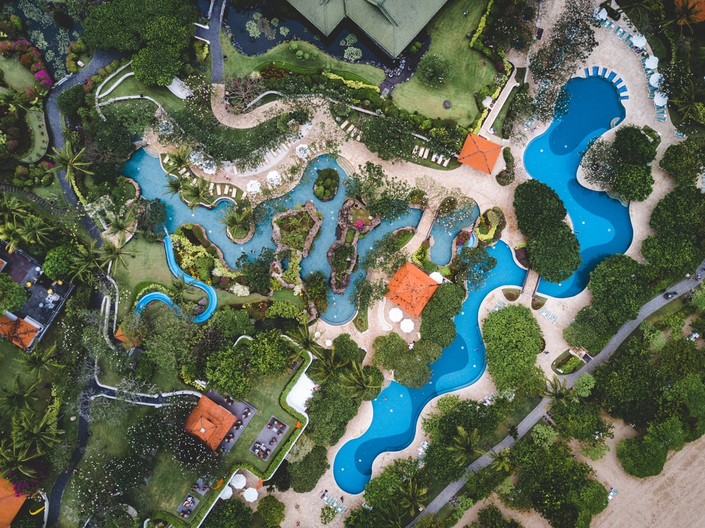 aerial photography of outdoor pool surrounded by houses