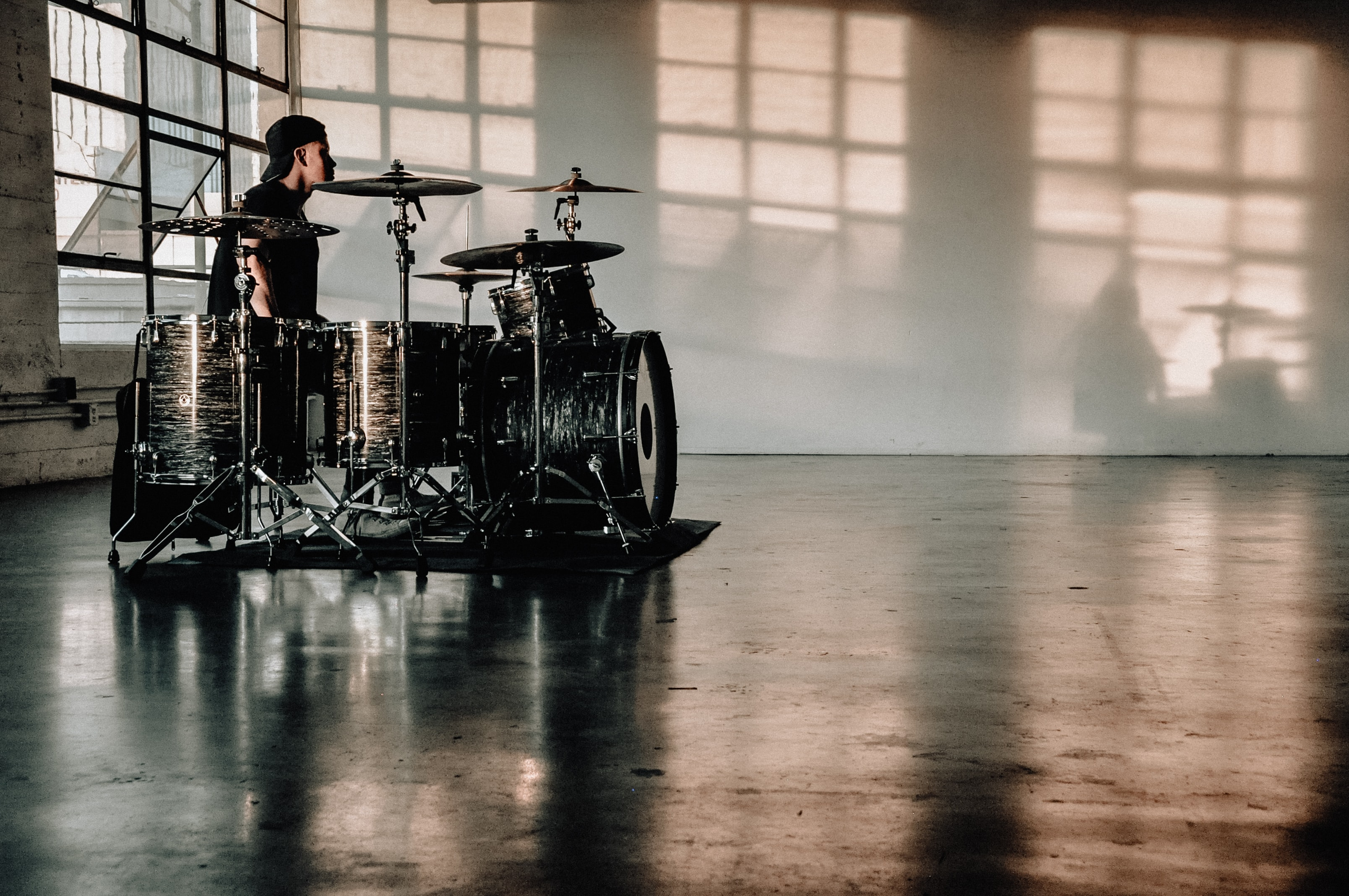 person in front of drumset