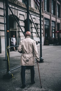 man walking near scaffolding during daytime