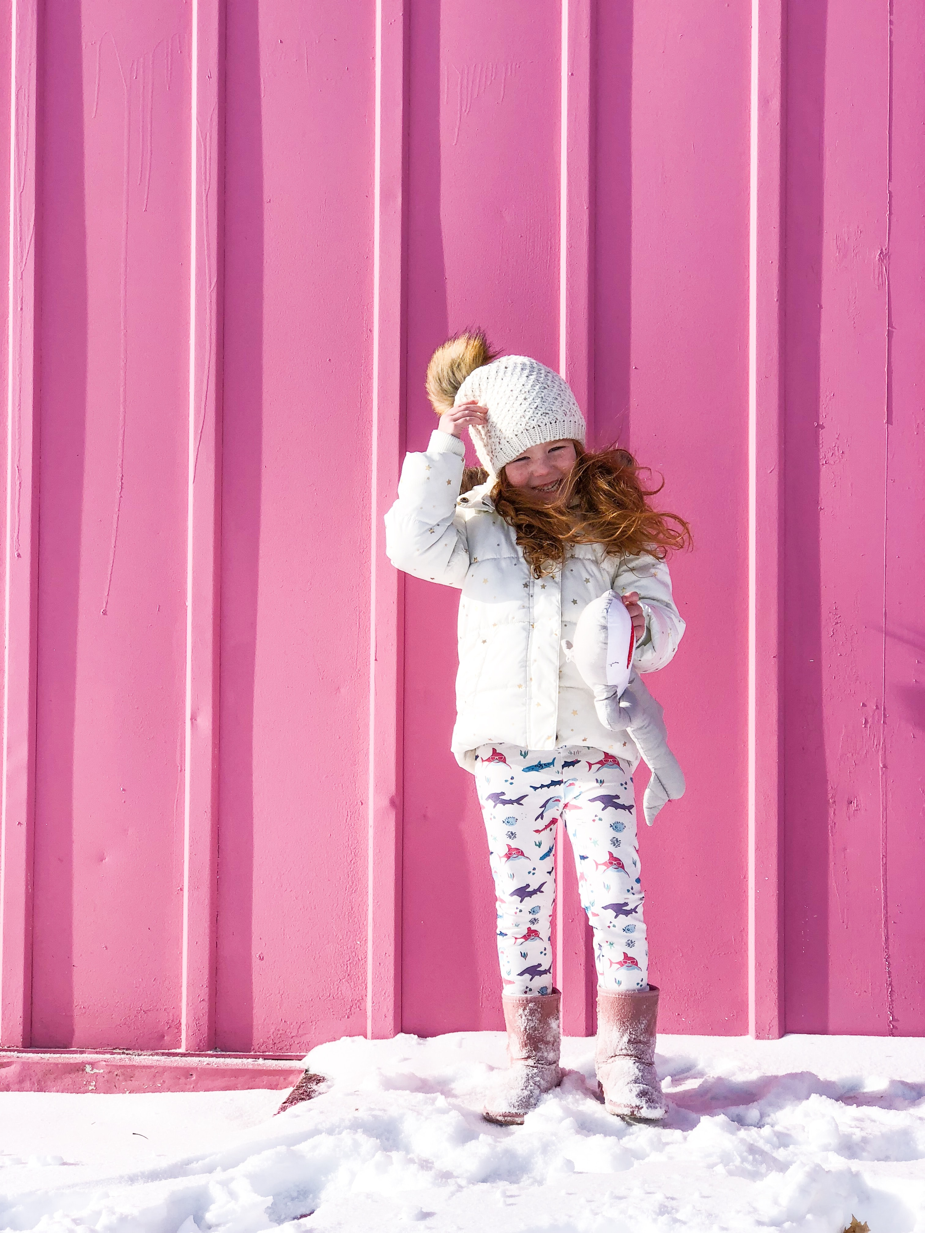 girl standing beside the wall