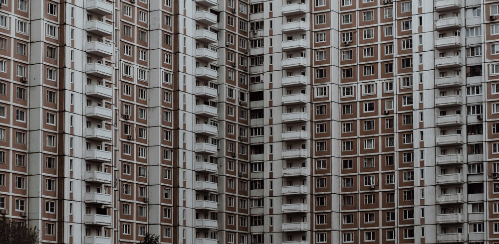 brown and white high-rise concrete building