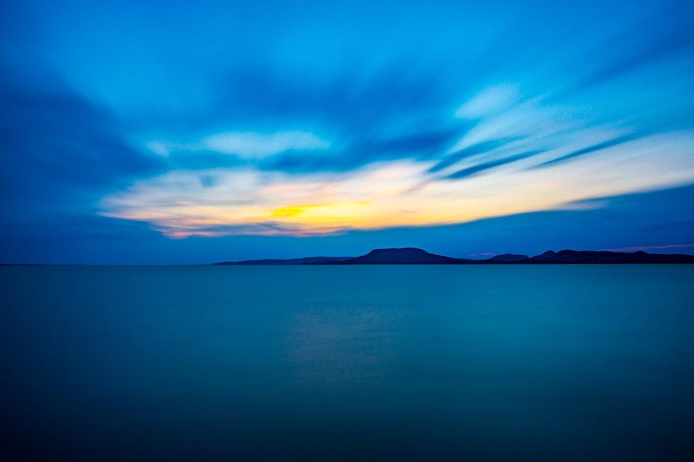 body of water under horizon